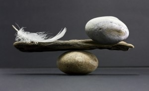 Balancing a feather and a rock